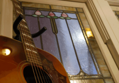 stained glass window and guitar