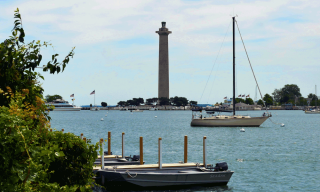 boats in bay with tall monument